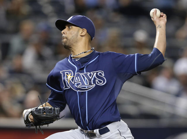 Tampa Bay Rays starting pitcher David Price delivers against the New York Yankees in the third inning of a baseball game, Wednesday, Sept. 25, 2013, in New York. (AP Photo/Kathy Willens)