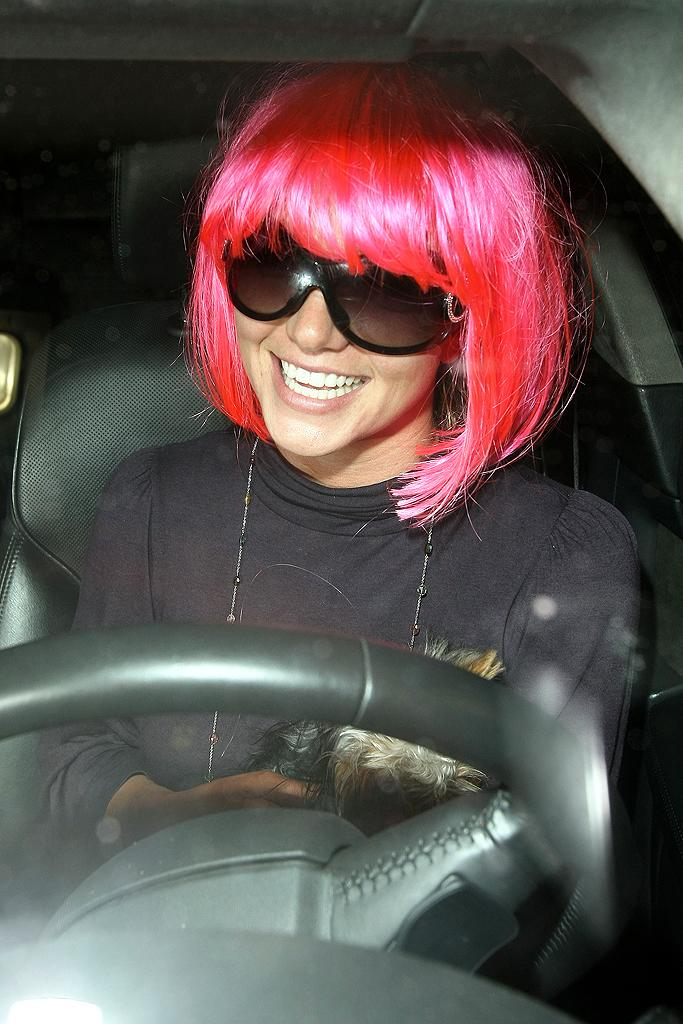 """As Britney's locks grew back, she debuted a number of different looks thanks to extensions and her favorite hairpiece: a pink wig. The pop star donned the wig all over, whether it was for dinner at the Four Seasons or late-night joy rides around L.A. """"When she puts on the pink wig, you just know something crazy is about to happen,"""" one paparazzo told People in January 2008. For example, while wearing the mop top, Britney was often overheard talking in a British accent. But when Brit's conservatorship kicked in, her father Jamie confiscated it, as evidenced by a photo in February 2008 of Mr. Spears carrying the wig out to his car. Where it is now is anyone's guess."""