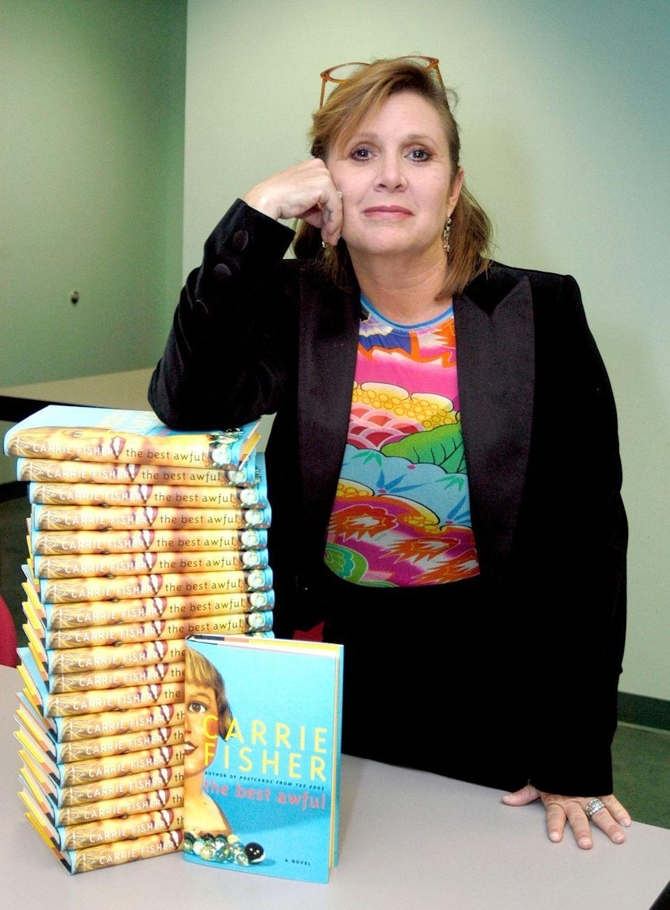 "<p>Carrie churned out another semi-autographical novel with <a href=""https://www.amazon.com/Best-Awful-Novel-Carrie-Fisher/dp/0743269306?tag=syn-yahoo-20&ascsubtag=%5Bartid%7C10055.g.32222003%5Bsrc%7Cyahoo-us"" rel=""nofollow noopener"" target=""_blank"" data-ylk=""slk:The"" class=""link rapid-noclick-resp""><em>The </em></a><em><a href=""https://www.amazon.com/Best-Awful-Novel-Carrie-Fisher/dp/0743269306"" rel=""nofollow noopener"" target=""_blank"" data-ylk=""slk:Best Awful"" class=""link rapid-noclick-resp"">Best Awful</a></em>. Her fourth novel used comedy to discuss the funny and sad aspects of living with a mental illness.</p>"