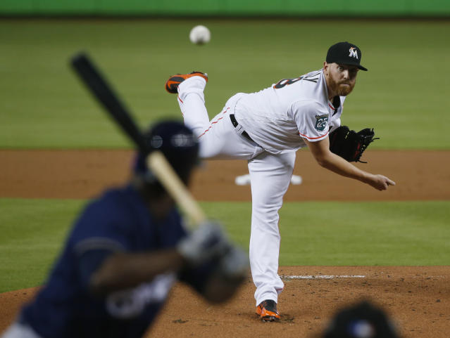 Miami Marlins' Dan Straily pitches to Milwaukee Brewers' Lorenzo Cain during the first inning of a baseball game Wednesday, July 11, 2018, in Miami. (AP Photo/Wilfredo Lee)