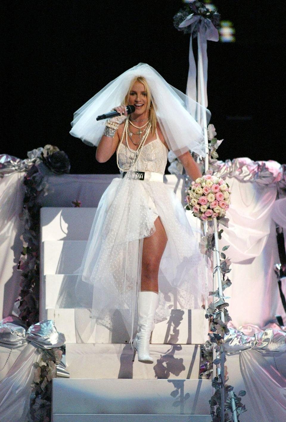 """<p>Britney Spears re-creates <a href=""""https://www.youtube.com/watch?v=gkSxhG4cbPo&ab_channel=Madonna"""" rel=""""nofollow noopener"""" target=""""_blank"""" data-ylk=""""slk:Madonna's classic &quot;Like a Virgin&quot; look"""" class=""""link rapid-noclick-resp"""">Madonna's classic """"Like a Virgin"""" look</a>.</p>"""