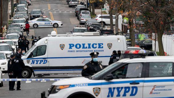 PHOTO: Police vehicles are parked near the scene of a shooting in the Bronx borough of New York City, Dec. 4, 2020. (Mark Lennihan/AP)