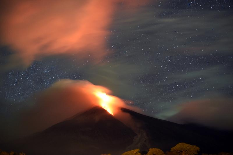 The Fuego volcano, seen from San Juan Alotenango municipality, Sacatepequez department, about 65 km southwest of Guatemala City, erupts on November 10, 2015