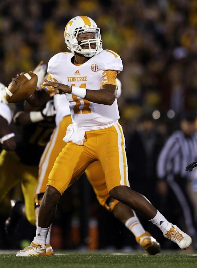 Tennessee quarterback Joshua Dobbs throws during the first half of an NCAA college football game against Missouri, Saturday, Nov. 2, 2013, in Columbia, Mo. (AP Photo/Jeff Roberson)