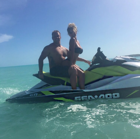 """<p>Kim captioned this pic of her and Kroy, 31, perched on a jet ski with a simple red-heart emoji. They really do seem to be in love. (Photo: <a href=""""https://www.instagram.com/p/BVFGWJBhg8d/"""" rel=""""nofollow noopener"""" target=""""_blank"""" data-ylk=""""slk:Kim Zolciak-Biermann via Instagram"""" class=""""link rapid-noclick-resp"""">Kim Zolciak-Biermann via Instagram</a>) </p>"""