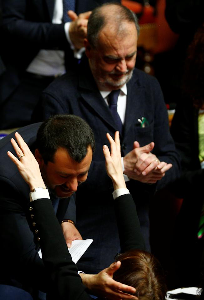 Deputy Prime Minister Matteo Salvini is hugged by a senator in the upper house of the Italian parliament, in Rome, Italy March 20, 2019. REUTERS/Yara Nardi