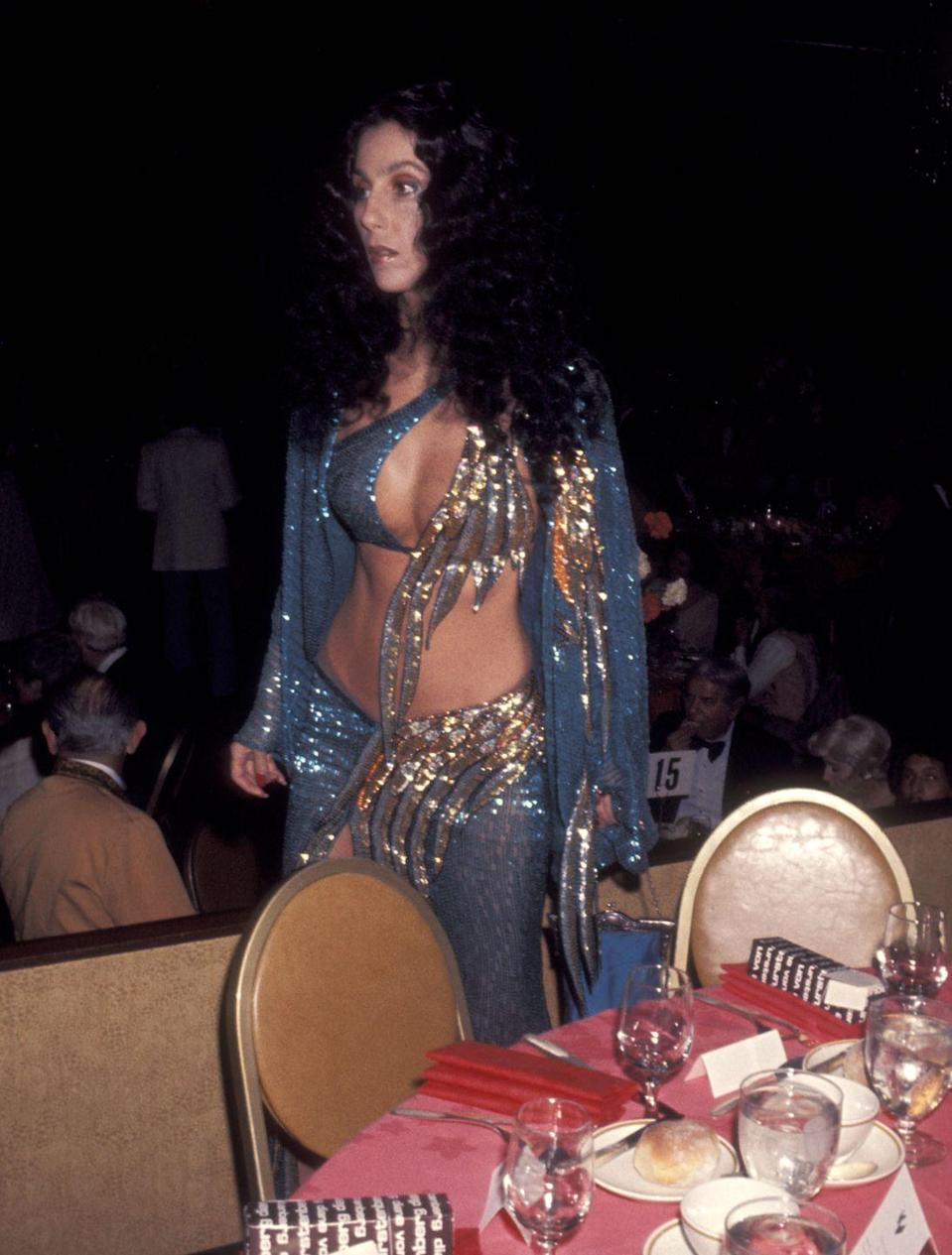 <p>Attending a dinner in a blue and gold sequined look. </p>