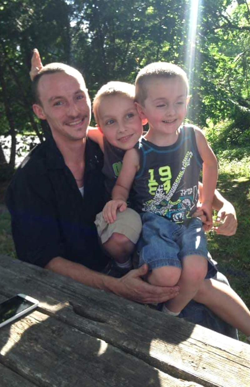 Steven Augustine, with his sons Michael, 7, and Steven Junior, 11 before the attack.