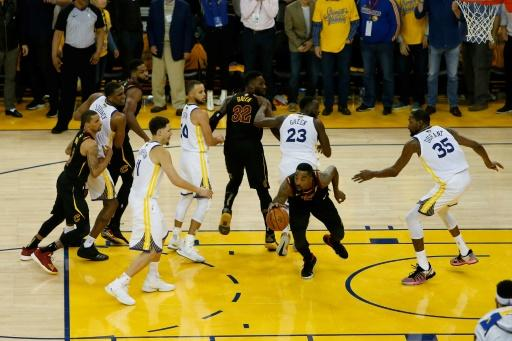 JR Smith of the Cleveland Cavaliers rebounds the ball after a free throw in the closing seconds against the Golden State Warriors apparently unaware the score was level