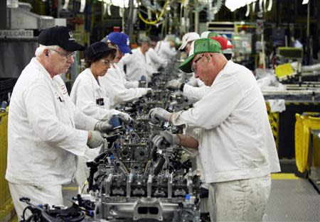 Anna Engine Plant associates are working on the engine assembly line in Anna, Ohio in this October 11, 2012 file photo taken during a tour of the Honda automotive engine plant. REUTERS/Paul Vernon/Files