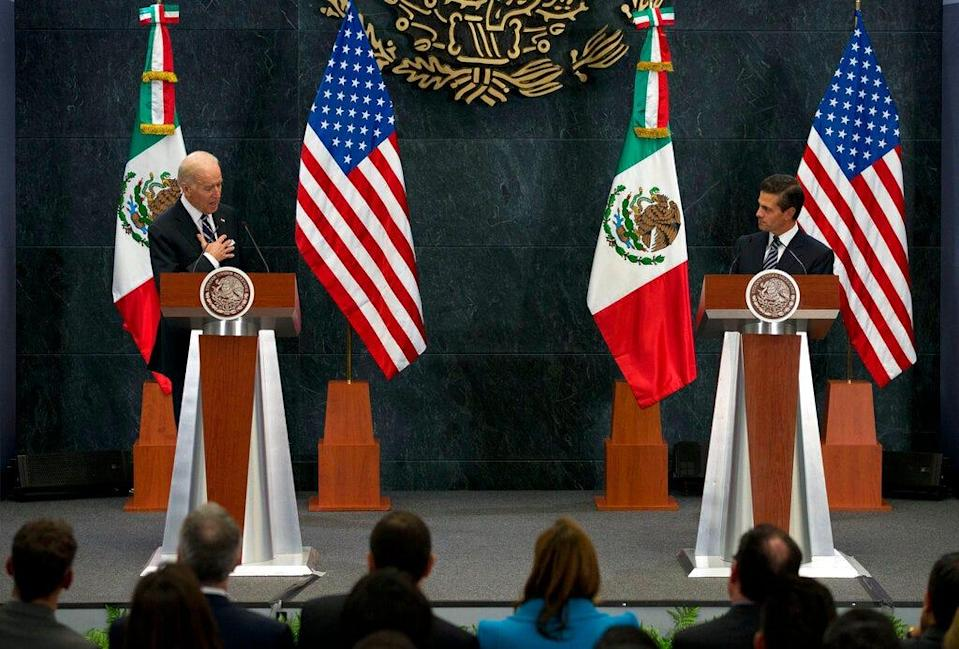 U.S. Vice President Joe Biden puts his hand to his chest as he tells Mexican President Enrique Pena Nieto that U.S. campaign rhetoric about Mexico and immigrants does not represent the view of most Americans, in Mexico City, Thursday, Feb. 25, 2016. Biden led a high-level U.S. delegation for annual talks on boosting economic and commercial ties with Mexico, one of the United States' top trading partners. (AP Photo/Rebecca Blackwell)