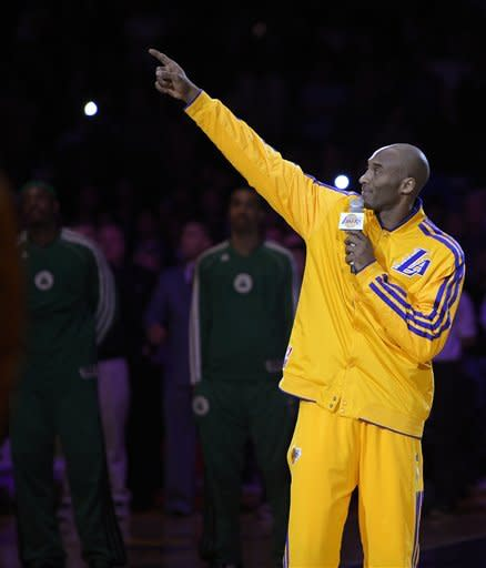 Los Angeles Lakers' Kobe Bryant point to the Buss family suite during a memorial for late owner Jerry Buss before an NBA basketball game between the Lakers and the Boston Celtics, Wednesday, Feb. 20, 2013, in Los Angeles. Buss died Monday after a battle with cancer. (AP Photo/Mark J. Terrill)