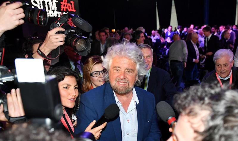 Five-Star Movement leader Beppe Grillo, right, attends a meeting of his party in Ivrea, near Turin, Italy, Saturday, April 8, 2017.  (Antonio Di Marco/ANSA via AP)