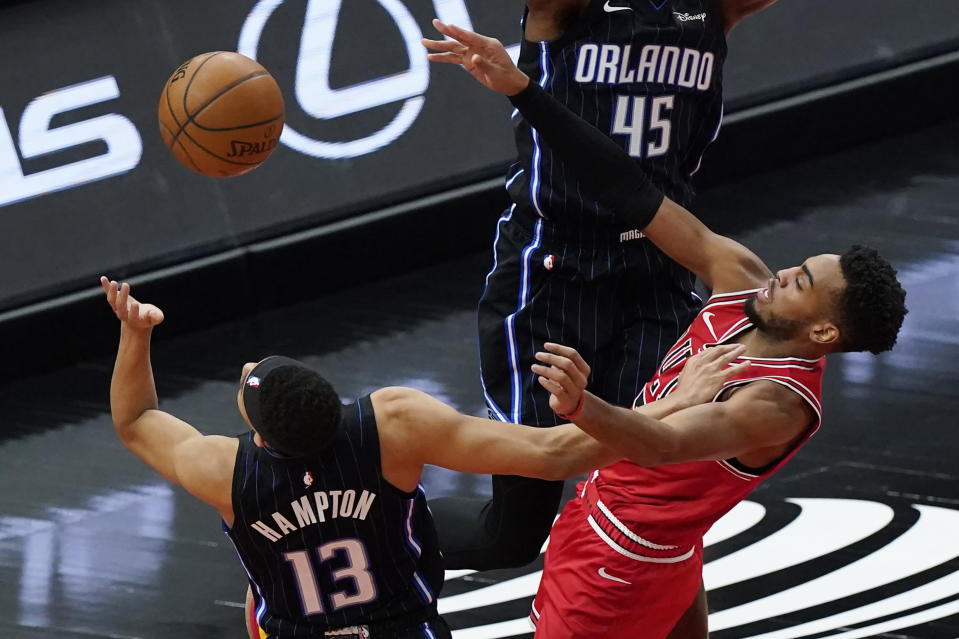 Orlando Magic guard R.J. Hampton, left, and Chicago Bulls forward Troy Brown Jr. vie for a rebound during the first half of an NBA basketball game in Chicago, Wednesday, April 14, 2021. (AP Photo/Nam Y. Huh)