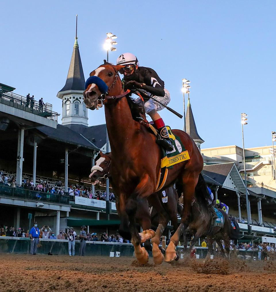 Authentic, with John Velazquez aboard, wins the Kentucky Derby at Churchill Downs on Saturday, September 5, 2020, with a small audience of onlookers.  The race was delayed from its normal home on the first Saturday in May.
