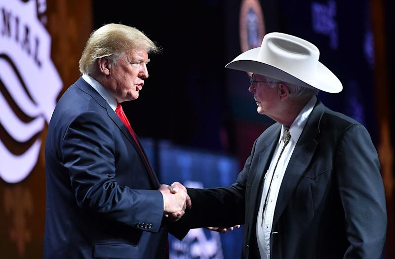 US President Donald Trump shakes hands with Arizona farmer Jim Chilton during the annual American Farm Bureau Federation convention in the Ernest N. Morial Convention Center in New Orleans, Louisiana on January 14, 2019. (Photo: MANDEL NGAN/AFP/Getty Images)