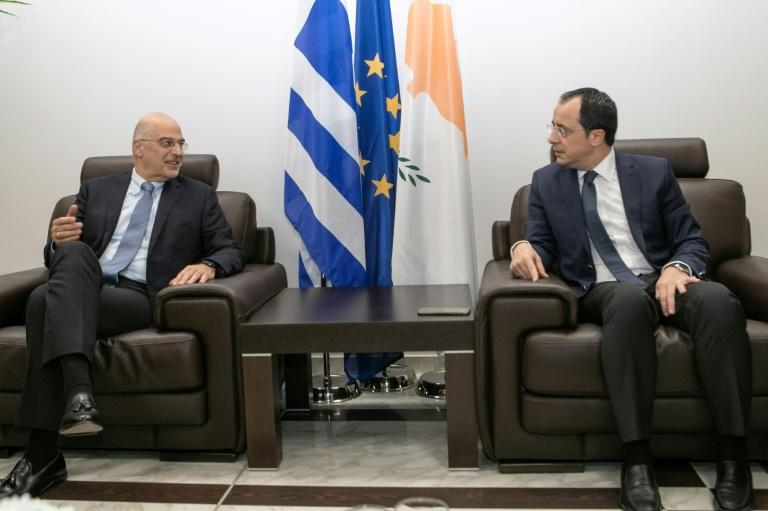 Cypriot Foreign Minister Nikos Christodoulides (R) met with his Greek counterpart Dendias at Larnaca airport near the end of the Greek diplomat's whistle-stop tour (AFP Photo/Stavros IOANNIDES)