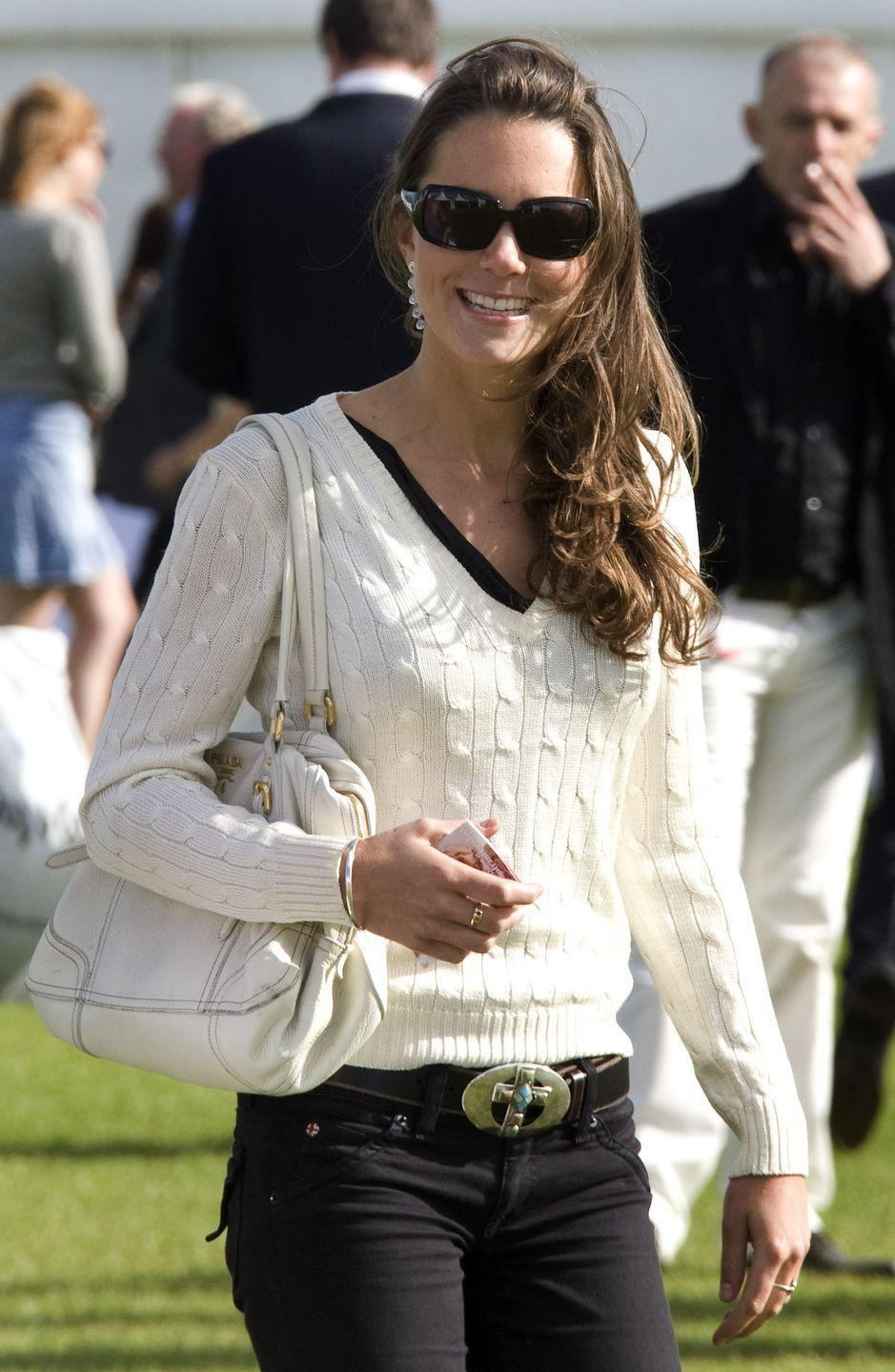<p>Sporting a v-neck sweater and dark jeans for a charity polo match at Beaufort Polo Club in Gloucestershire.</p>