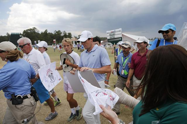 Rory McIlroy, of Northern Ireland, leaves the course after practice was suspended due to weather at the U.S. Open golf tournament in Pinehurst, N.C., Wednesday, June 11, 2014. The tournament starts Thursday. (AP Photo/Charlie Riedel)