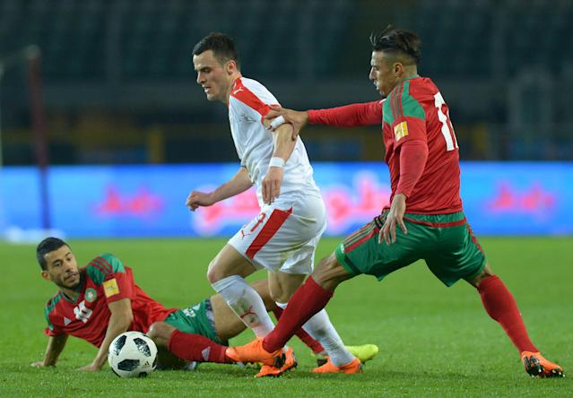 Soccer Football - International Friendly - Serbia vs Morocco - Stadio Olimpico Grande Torino, Turin, Italy - March 23, 2018 Serbia's Filip Kostic in action with Morocco's Nabil Dirar and Younes Belhanda REUTERS/Massimo Pinca