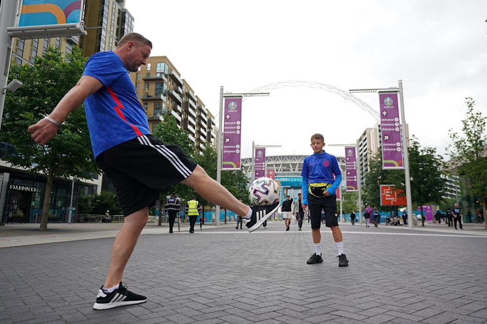 Fans play football outside Wembley Stadium several hours before the semi-final match with Denmark (PA Wire)