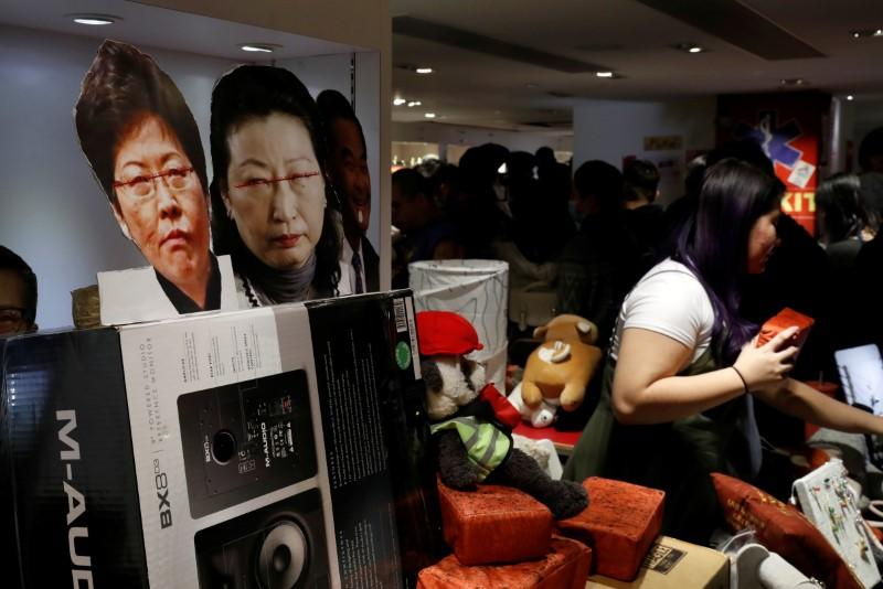 Images of Hong Kong's Chief Executive Lam and Justice Secretary Cheng Yuet-wah are seen at a booth of independent fairs, selling protest-themed artwork, toys and accessories, ahead of Lunar New Year in Hong Kong