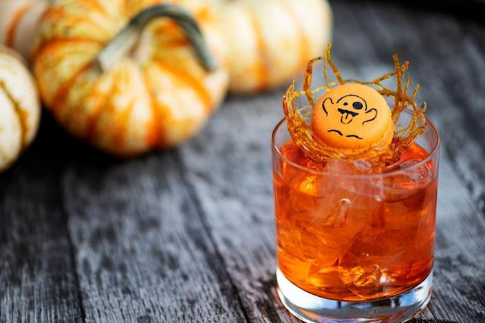 """<p><strong>Ingredients</strong></p><p>1 oz Singani 63 Brandy<br>.75 oz Aperol<br>.25 oz Salers Aperitif<br>1 oz Cocchi Americano Wine</p><p><strong>Instructions</strong></p><p>Stir and serve on the rocks. Garnish with a sugar cage and a festive pumpkin macaroon with a ghost drawing</p><p><em>By Beverage Director Rael Petit of <a href=""""http://www.sevenseedswilliamsburg.com/"""" rel=""""nofollow noopener"""" target=""""_blank"""" data-ylk=""""slk:Seven Seeds"""" class=""""link rapid-noclick-resp"""">Seven Seeds</a></em></p>"""