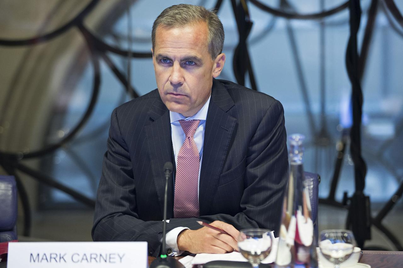 LONDON - UNITED KINGDOM - JULY 01: Mark Carney, governor of the Bank Of England, attends a monetary policy committee (MPC) briefing on his first day inside the central bank's headquarters on July 1, 2013 in London, England. Carney takes the Bank Of England helm today, facing a struggle to make his policies count more than those of his US counterpart for UK government debt. (Photo by Jason Alden - Pool/Getty Images)