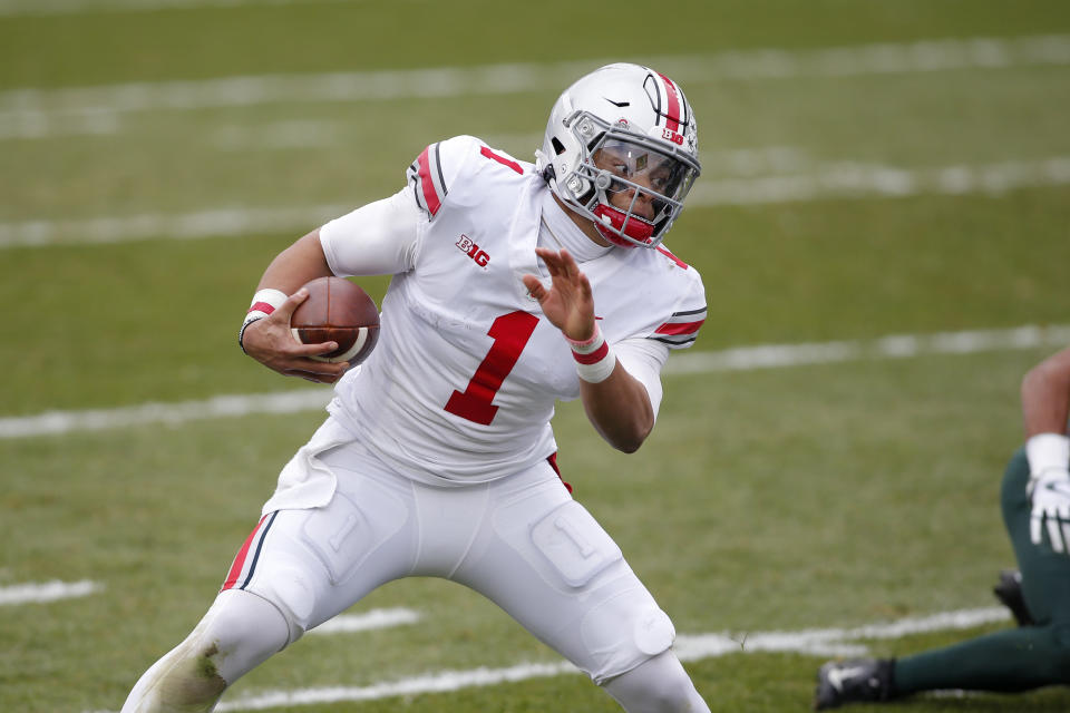 Justin Fields might have to wait, but he'll start games as a rookie for the Chicago Bears. (AP Photo/Al Goldis)