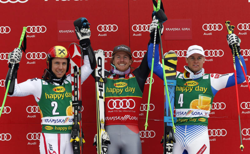 Ted Ligety, of the United States, center, winner of an alpine ski, men's World Cup giant slalom, celebrates on the podium with second placed Marcel Hirscher, of Austria, left, and France's Alexis Pinturault, third, in Kranjska Gora, Slovenia, Saturday, March 9, 2013. (AP Photo/Alessandro Trovati)