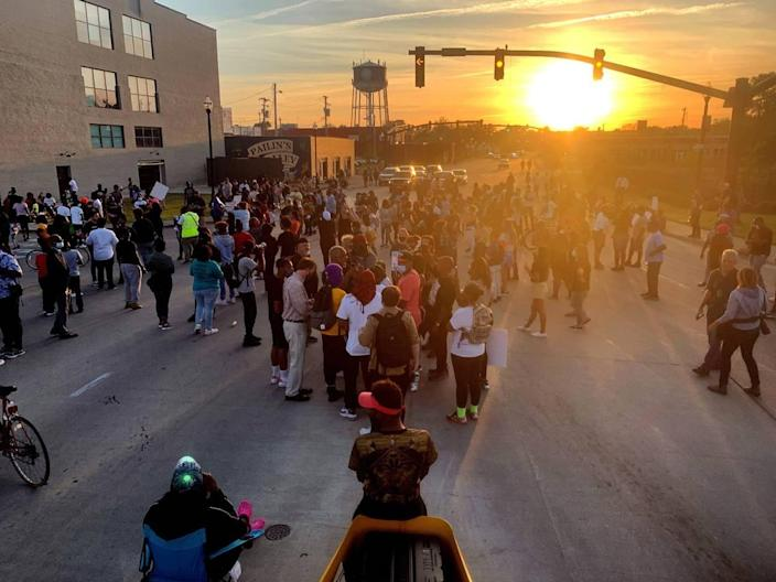 Protesters block the US Highway 158 bridge over Pasqoutank River in Elizabeth City, N.C. Tuesday evening in advance of an 8pm curfew ordered by the city. Protests continued Tuesday following the shooting death of Andrew Brown Jr. last week by Pasquotank County sheriff's deputies.