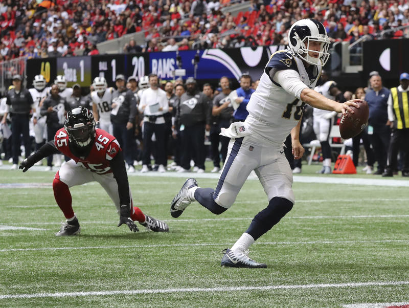 Los Angeles Rams quarterback Jared Goff, right, gets past Atlanta Falcons linebacker Deion Jones for a touchdown during the second half of an NFL football game Sunday, Oct, 20, 2019, in Atlanta. (Curtis Compton/Atlanta Journal-Constitution via AP)