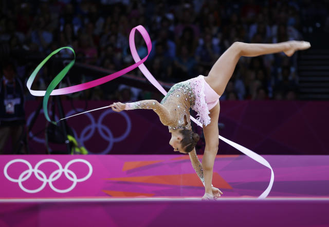 Russia's Evgeniya Kanaeva competes using the ribbon in the individual all-around rhythmic gymnastics final at Wembley Arena during the London 2012 Olympic Games August 11, 2012. REUTERS/Marcelo Del Pozo (BRITAIN - Tags: SPORT GYMNASTICS OLYMPICS)