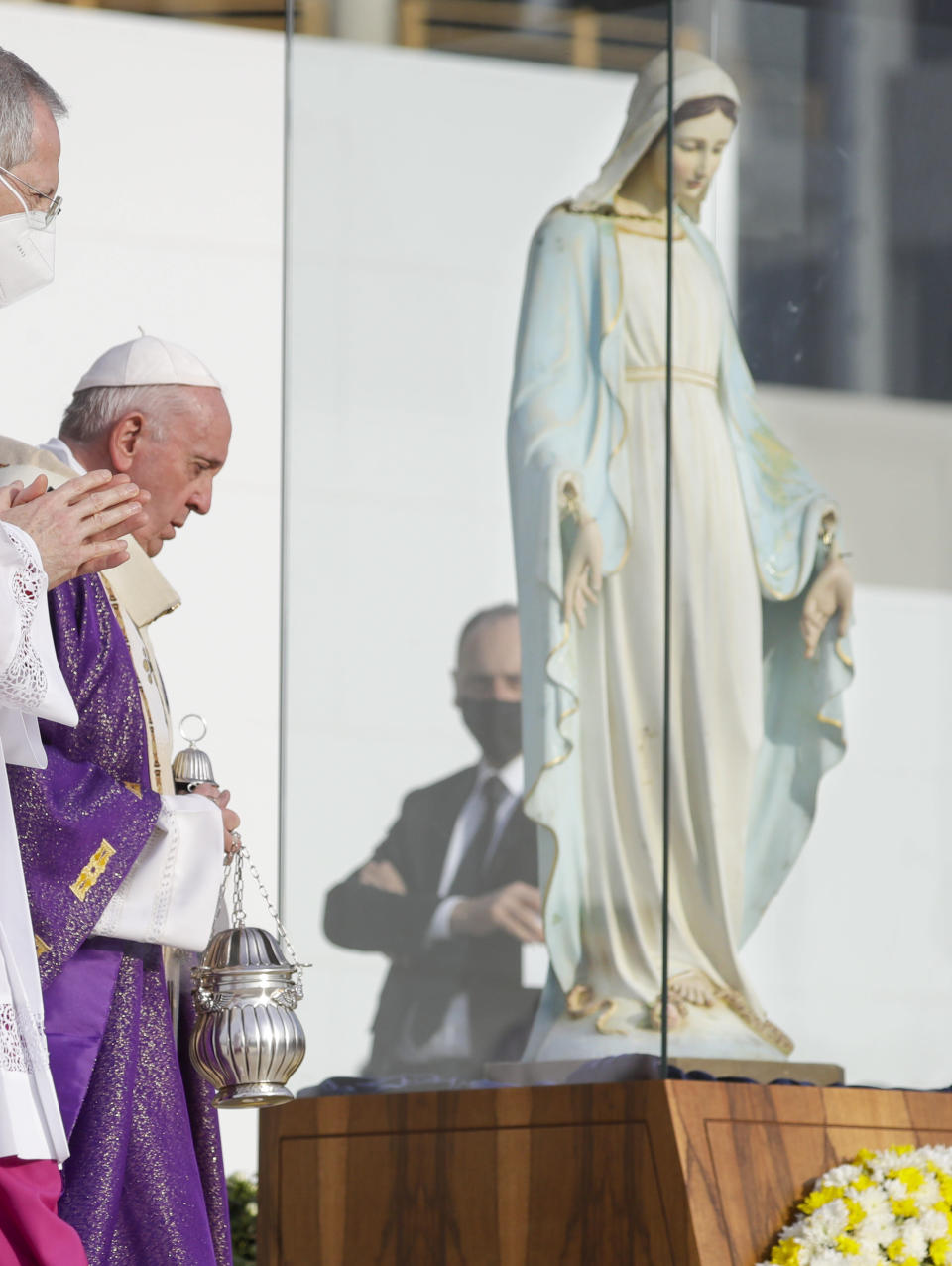 Pope Francis blesses a statue of the Virgin Mary that was vandalized by IS in the Christian village of Karemlash, 29 kilometers south east of Mosul, as he celebrates mass at the Franso Hariri Stadium in Irbil, Kurdistan Region of Iraq, Sunday, March 7, 2021. The statue is being restaurated after it was beheaded and its hands chopped during the occupation by the IS of the Nineveh Plains between 2014 and 2017. (AP Photo/Andrew Medichini)