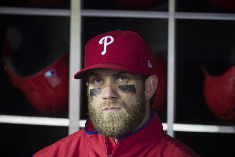Philadelphia Phillies' Bryce Harper watches a video tribute in honor of him from the dugout before a baseball game against the Washington Nationals at Nationals Park, Tuesday, April 2, 2019, in Washington. (AP Photo/Alex Brandon)