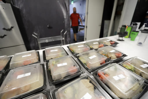 This Oct. 8, 2018, photo, shows lunch boxes awaiting Breakfast Club members at Exos in Carlsbad, Calif. The Breakfast Club is a free six-week program bringing former players together for three workouts a week while offering physical therapy and a nutritionist. (AP Photo/Gregory Bull)