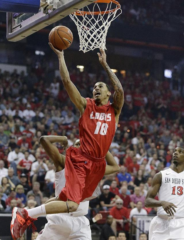 New Mexico's Kendall Williams shoots over San Diego State's Winston Shepard (10) during the first half of an NCAA college basketball game for the Mountain West Conference tournament championship on Saturday, March 15, 2014, in Las Vegas. (AP Photo/Isaac Brekken)