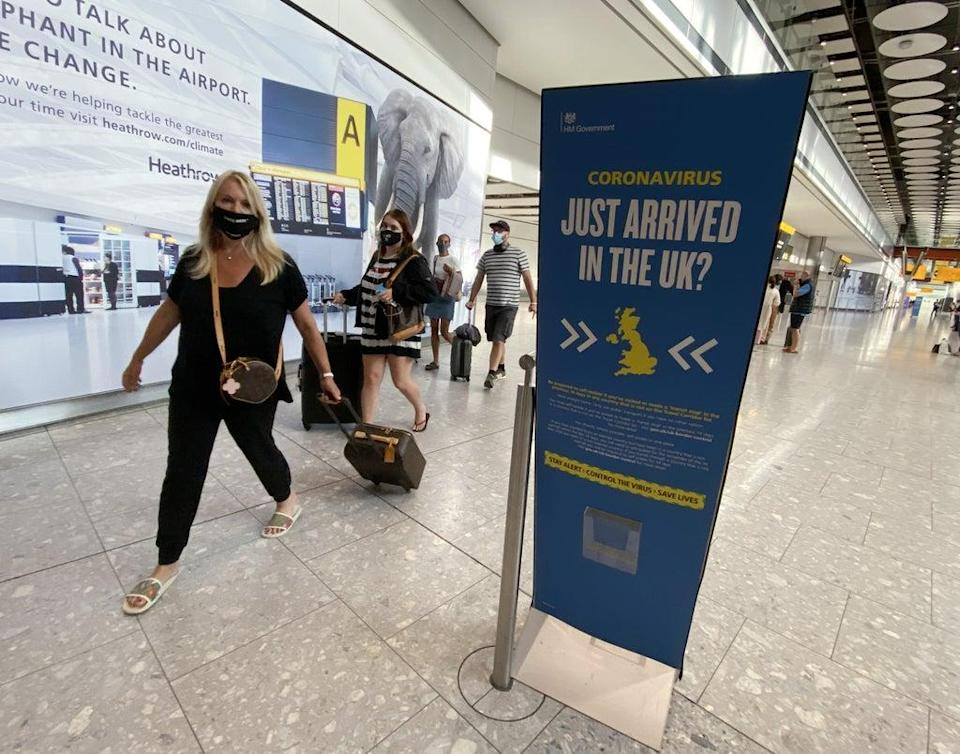 Passengers arrive at Heathrow Airport (Yui Mok/PA) (PA Archive)