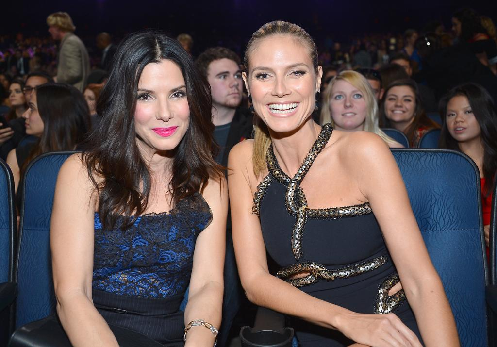 LOS ANGELES, CA - JANUARY 09: Actress Sandra Bullock (L) and Heidi Klum attend the 39th Annual People's Choice Awards at Nokia Theatre L.A. Live on January 9, 2013 in Los Angeles, California. (Photo by Frazer Harrison/Getty Images for PCA)