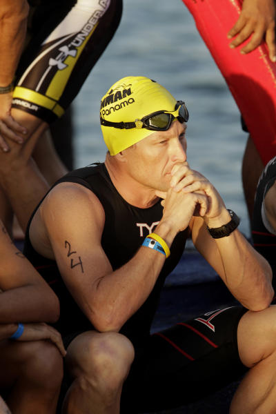 "FILE - In this Feb. 12, 2012, file photo, Lance Armstrong waits for the start of the Ironman Panama 70.3. triathlon in Panama City, Panama. The U.S. Anti-Doping Agency is bringing doping charges against the seven-time Tour de France winner, questioning how he achieved those famous cycling victories. Armstrong, who retired from cycling last year, could face a lifetime ban from the sport if he is found to have used performance-enhancing drugs. He maintained his innocence, saying: ""I have never doped."" (AP Photo/Arnulfo Franco, File)"
