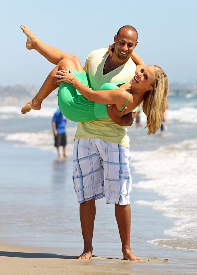 """The former """"Girls Next Door"""" star has a lot to smile about. Not only is Kendra madly in love with Hank, but she's in love with her fit physique as well. """"Loving my body,"""" she tweeted after posting a <a href=""""http://kendrawilkinson.celebuzz.com/2011/07/exercise-ab-cuts/"""" target=""""new""""> post-workout photo of herself</a> on Twitter. Gaz Shirley/Kevin Perkins/<a href=""""http://www.PacificCoastNews.com"""" target=""""new"""">PacificCoastNews.com</a> - July 19, 2011"""