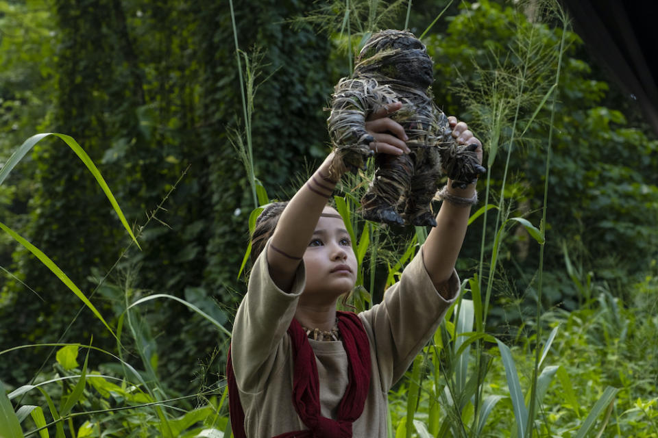 Jai (Kaylee Hottle) reaches out in Godzilla vs. Kong. (PHOTO: Warner Bros Pictures)