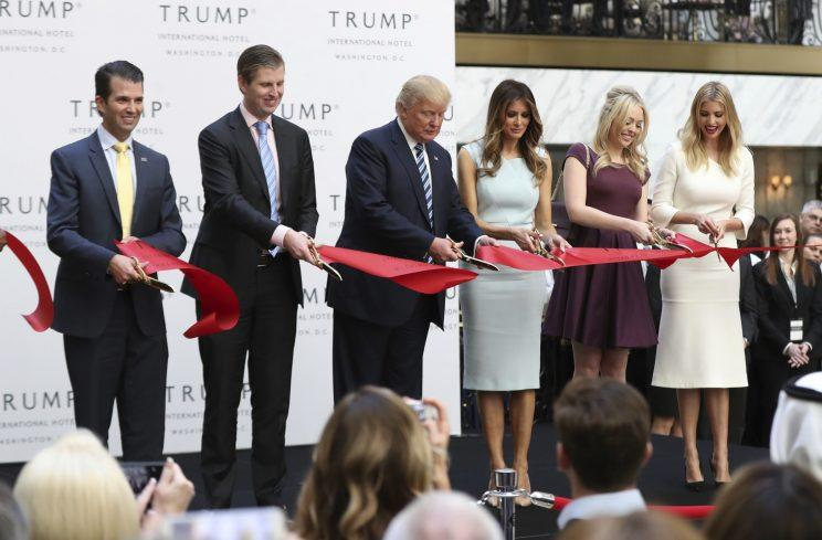Donald Trump and family members cut the ribbon for the opening of Trump International Hotel, October 2016