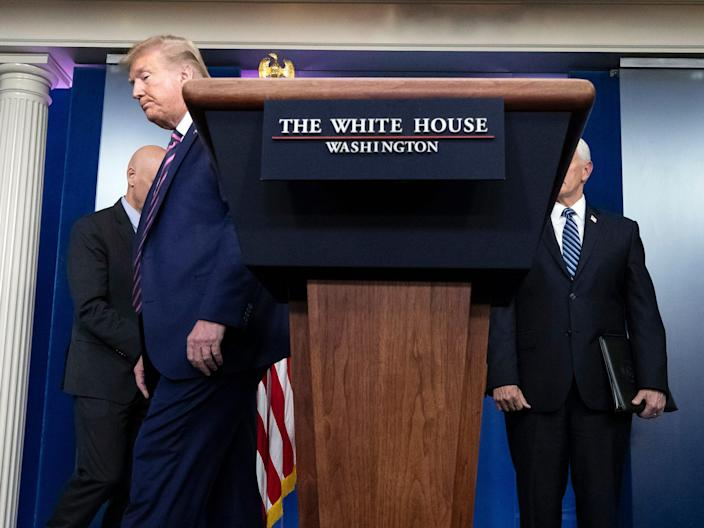 President Donald Trump steps away from the lectern to allow Stephen Hahn, commissioner of the U.S. Food and Drug Administration, to speak about the coronavirus in the James Brady Press Briefing Room of the White House, Friday, April 24, 2020, in Washington. (AP Photo/Alex Brandon)