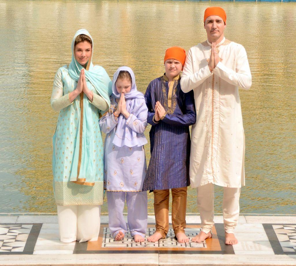 <p><strong>When: Feb. 21, 2018</strong><br /> Canadian Prime Minister Justin Trudeau, who was presented with a siropa (a traditional robe of honour) at the temple, opted for a white kurta-pyjama and saffron-coloured fabric to cover his head, while Sophie stunned in a punjabi suit as she prayed at the sanctum sanctorum. <em>(Photo: Getty)</em> </p>
