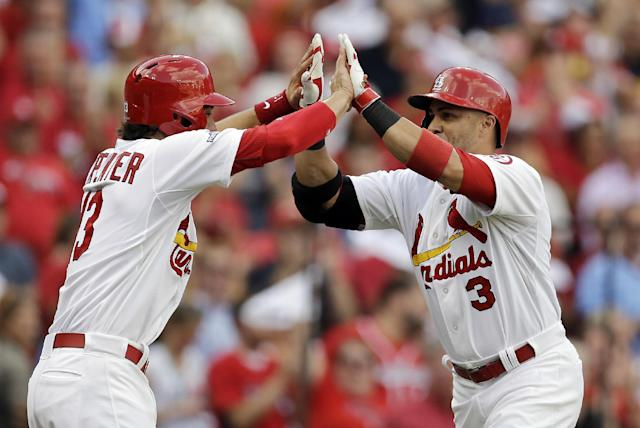 St. Louis Cardinals' Carlos Beltran (3) is congratulated by Matt Carpenter (13) after Beltran hit a three-run home run against the Pittsburgh Pirates in the third inning of Game 1 of baseball's National League division series on Thursday, Oct. 3, 2013, in St. Louis. (AP Photo/Jeff Roberson)