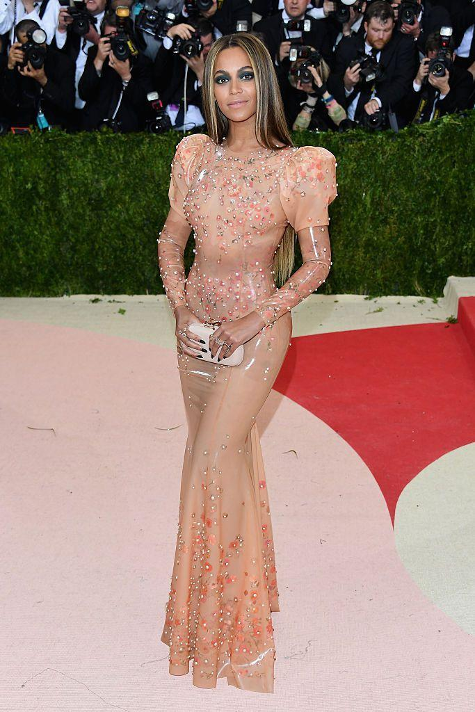 """<p>Beyoncé mastered the art of the naked dress, with some help from Givenchy, when she slipped into a custom gown for the Met Gala. This marked the fifth time Queen Bey wore Givenchy to the annual event - and it wasn't even the most revealing one (that would be her bejewelled gown from 2015). This skin-tone number, designed by Riccardo Tisci, fit like a latex glove, because it was indeed made from the slick material and embellished with delicate beadwork. <br><br>Beyoncé's solo attendance to the gala was notable because at the time she had released <em>Lemonade, </em>which confirmed rumours about Jay-Z's infidelity. """"I'm so reckless when I rock my Givenchy dress,"""" she sings in """"Formation,"""" a single from the aforementioned album. Indeed Bey, you are. </p>"""