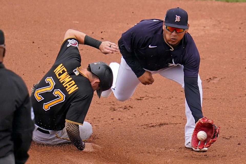 Detroit Tigers second baseman Isaac Paredes, right, takes the late throw from catcher Wilson Ramos as Pittsburgh Pirates' Kevin Newman (27) steals second during the first inning in Lakeland, Florida, on Saturday, March 20, 2021.