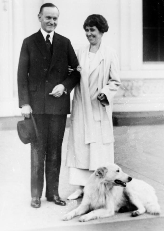 "This Nov. 5, 1924 file photo shows President Calvin Coolidge and first lady Grace Coolidge  with their dog at the White House portico. The election's not over for seventh-graders weighing in on what President-elect Barack Obama calls a ""major issue"" _ choosing the breed of the next first dog. (AP Photo/FILE)"