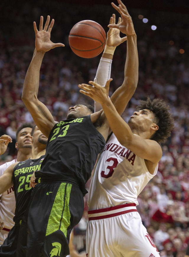 Michigan State forward Xavier Tillman (23) and Indiana forward Justin Smith (3) battle for a rebound during the second half of an NCAA college basketball game, Saturday, March 2, 2019, in Bloomington, Ind. Indiana won 63-62. (AP Photo/Doug McSchooler)